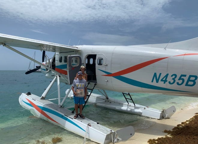 Visiting Dry Tortugas: Jack and Nancy Westbrook of St. Augustine on Key West seaplane to Fort Jefferson Dry Tortugas National Park. (Masks were removed for picture!) special day as the ferry wasn't running, so only about 12 people on the island. A rare event!