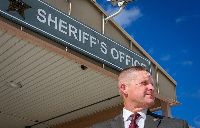 St. Augustine Beach Police Chief Robert Hardwick stands in front of the St. Johns County Sheriff's Office headquarters in St. Augustine on Friday. Hardwick won the republican primary last week to replace county Sheriff Davis Shoar who is retiring. [PETER WILLOTT/THE RECORD]