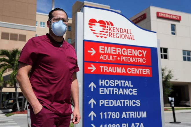 Rublas Ruiz poses for a photograph outside of Kendall Regional Medical Hospital where he works as a nurse in the hospital's intensive care unit on August 11 in Miami. While other nurses rotate in and out of the COVID-19 ICU unit to limit their exposure to the deadly virus, Ruiz has asked to stay permanently.