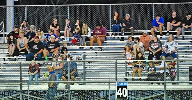 Asbury football fans practice social distance during high school football action in Gadsden, Alabama August 21, 2020.