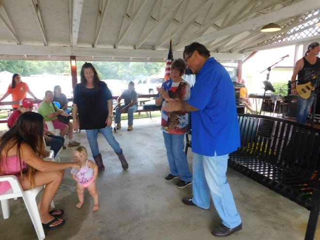 Cassidy  Handy  entertains the crowd and other dancers enjoying the music of the Still Kicking band in the pavilion at Leesburg Day 2019.
