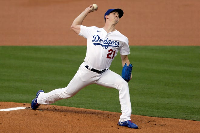 Los Angeles Dodgers starting pitcher Walker Buehler throws to the plate against the Colorado Rockies during the first inning of a baseball game in Los Angeles, Friday, Aug. 21, 2020.