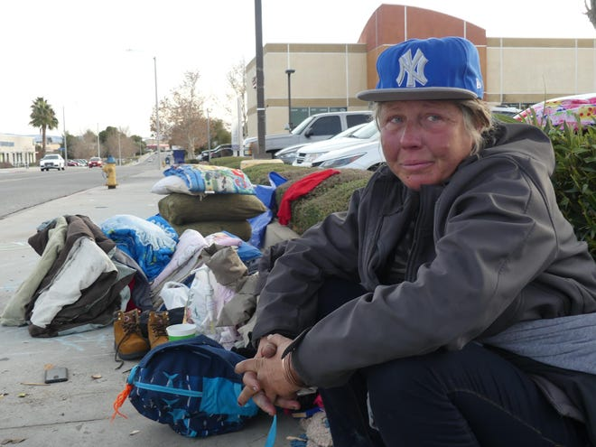 A woman named Dana discusses what it takes to survive while living homeless in Victorville in this April 2020 photo.