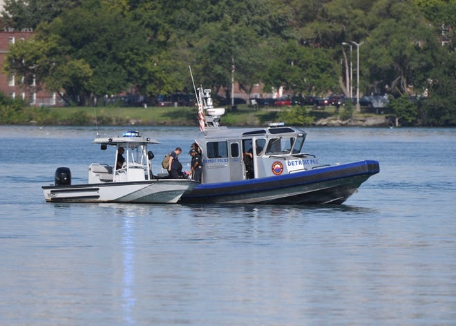 The Detroit Police continue to search for a missing person along Belle Isle beach on Saturday, August 22, 2020.