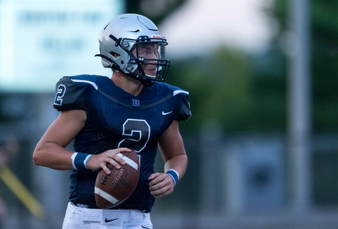 Reitz's Reid Brickey (2) looks for an open receiver as the Panthers play the Harrison Warriors at the Reitz Bowl in Evansville, Ind., Friday evening Aug. 21, 2020.