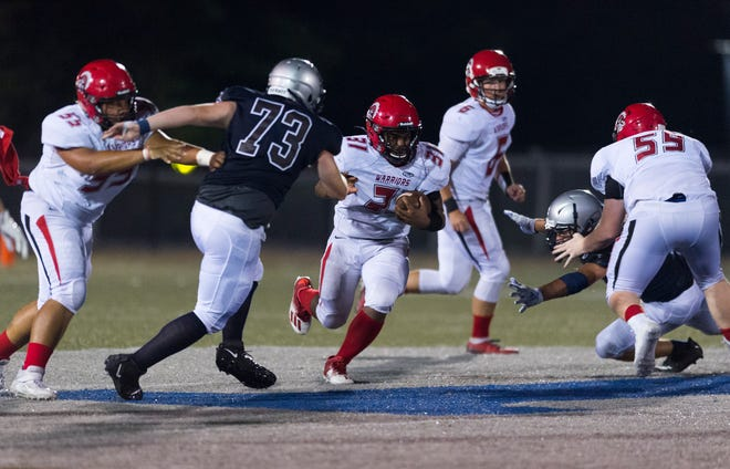 Albert Wadlington (31), carrying against Reitz, gained 151 yards rushing in Harrison's 18-0 win over Bosse on Friday night.