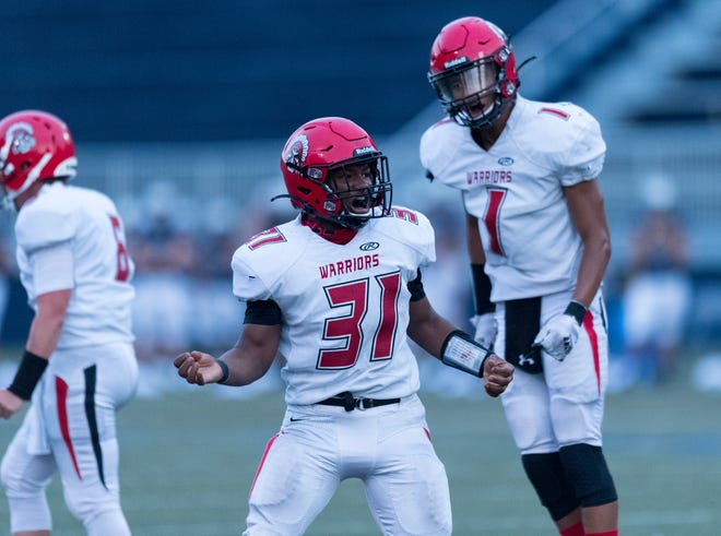 Harrison's Albert Wadlington (31) celebrates a touchdown as the Warriors face the Reitz Panthers at the Reitz Bowl in Evansville, Ind., Friday evening Aug. 21, 2020.