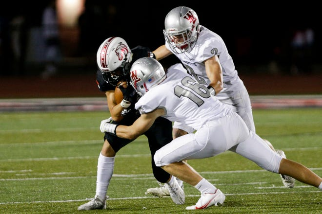 Lafayette Jeff wide receiver Asa Koeppen (4) is tackled by West Lafayette's Sam Schott (16) and West Lafayette's JT Downey (2) during the third quarter of an IHSAA football game, Friday, Aug. 21, 2020 in Lafayette.