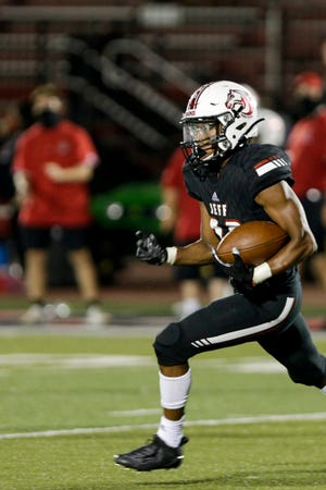 Lafayette Jeff tailback Thomas Hogan (28) runs the ball during the fourth quarter of an IHSAA football game, Friday, Aug. 21, 2020 in Lafayette.