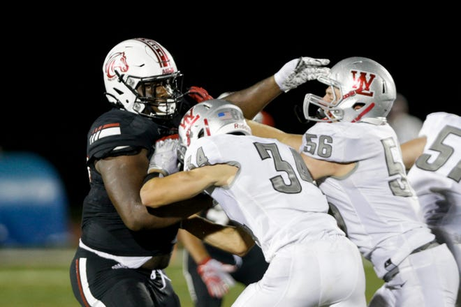Lafayette Jeff defensive tackle Jalen Monrrow fights through a block against West Lafayette.