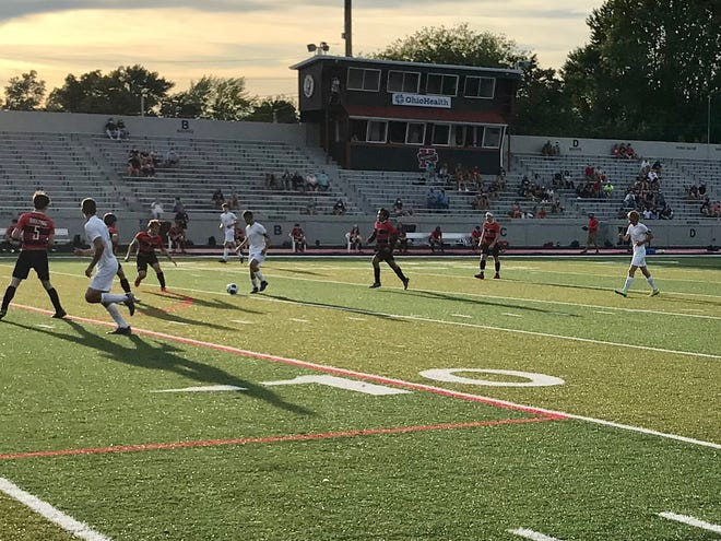Fans are socially distanced in the main grandstand at Harding Stadium Friday night during Marion Harding's doubleheader soccer match with River Valley. All fall sports scholastic contests in Ohio will be held with limited fan access this year due to the coronavirus pandemic.