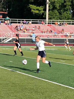 River Valley's Annabelle Gandert tracks down a pass during the 2020 girls soccer opener against Marion Harding at Harding Stadium.