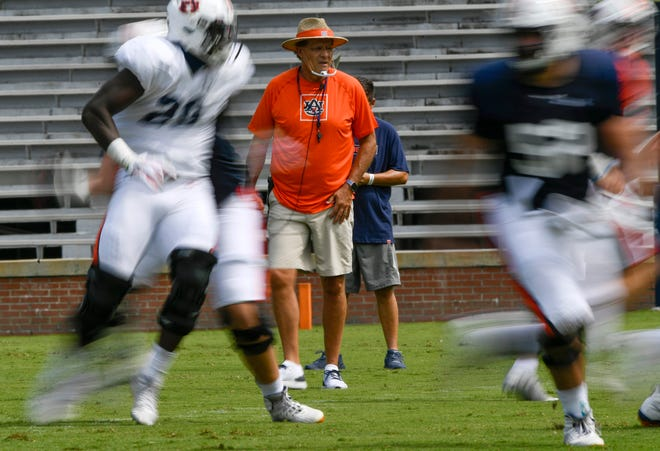 Auburn coach Coach Gus Malzahn watches his team scrimmage at Jordan-Hare Stadium on Saturday, Aug. 22, 2020 in Auburn, Ala.