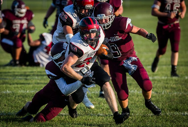 Blackford's Quinten Teer fights past Wes-Del's defense during their game at Wes-Del High School Friday, Aug. 21, 2020.