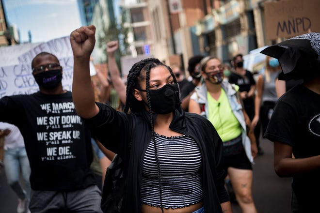 Demonstrators including Rienne Hill, 16, march in downtown Nashville on Saturday.The protest, organized by Teens4Equality, was in response to a new law that increases penalties for protesters who camp on state property and criminalizes marking with chalk on a government building.