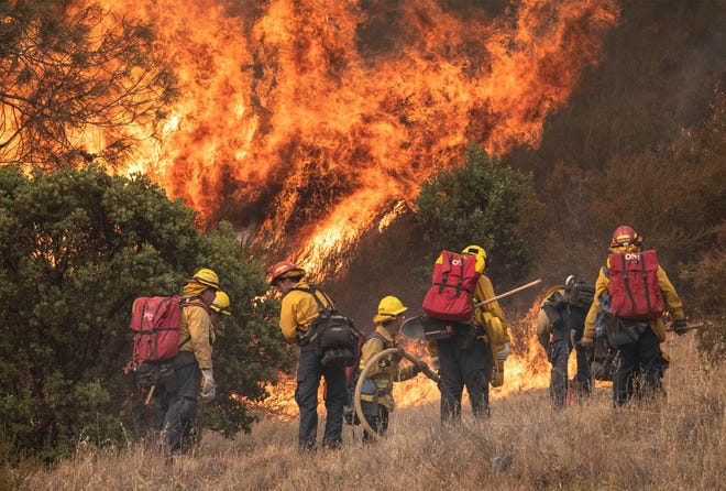 Crews battle the Moc Fire near Moccasin Reservoir on Highway 49 and Marshes Flat Road. The quickly spreading fire engulfed 2,800 acres threatening Groveland, Big Oak Flat, Moccasin and Coulterville.