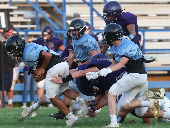 TLCA quarterback Sterling Harding fights for yardage against San Saba in a preseason scrimmage at Lake View Stadium on Friday, Aug. 21, 2020.