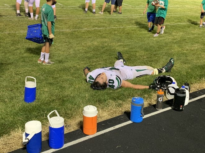 MCM running back Jacobi Krouse spreads out to rest his legs after scoring the fourth of his five touchdowns in Friday's win over Beresford.