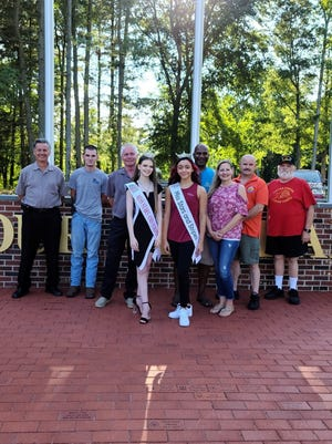 Commercial Township Mayor Mike Vizzard, Deputy Mayor Fletcher Jamison and committee members of the Veterans Memorial Park in Commercial Township met with Miss Stars and Stripes Jessenia Rivera (front row, center) and Miss Stars and Stripes Outstanding Teen Samantha Layton (front row, left) to acknowledge their efforts to beautify the park for National Purple Heart Day.