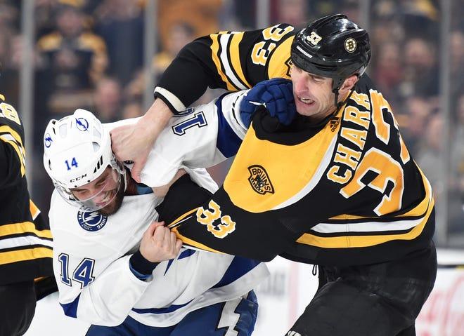 Tampa Bay Lightning forward Pat Maroon and Boston Bruins defenseman Zdeno Chara fight during a March game.