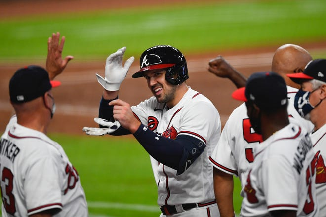The Braves' Adam Duvall celebrates his game-winning hit in the bottom of the ninth inning Saturday against the Phillies.