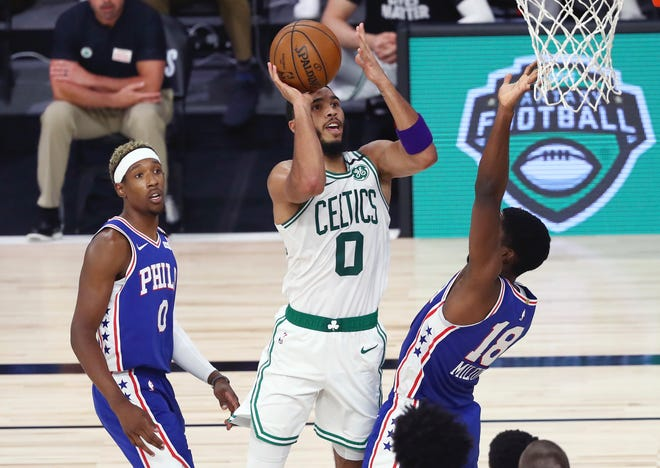 Celtics forward Jayson Tatum shoots over 76ers guard Shake Milton during the third quarter of Game 4  on Sunday afternoon.