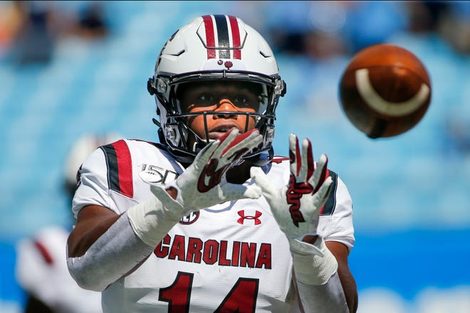 South Carolina running back Deshaun Fenwick warms up prior to a 2019 game against North Carolina in Charlotte, N.C. For the college athletes who are heading into a season of uncertainty brought on by COVID-19, the NCAA's decision to not charge them a year of eligibility, no matter how much they play, brings peace of mind.