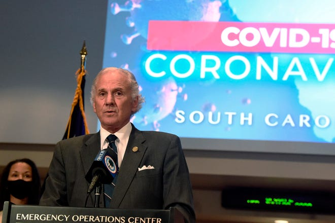 South Carolina Gov. Henry McMaster, right, speaks during a COVID-19 briefing.