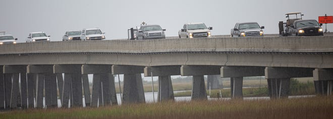 Cars stream north along La. 1 today near Leeville as Grand Isle residents evacuate in advance of Hurricane Marco and Tropical Storm Laura.