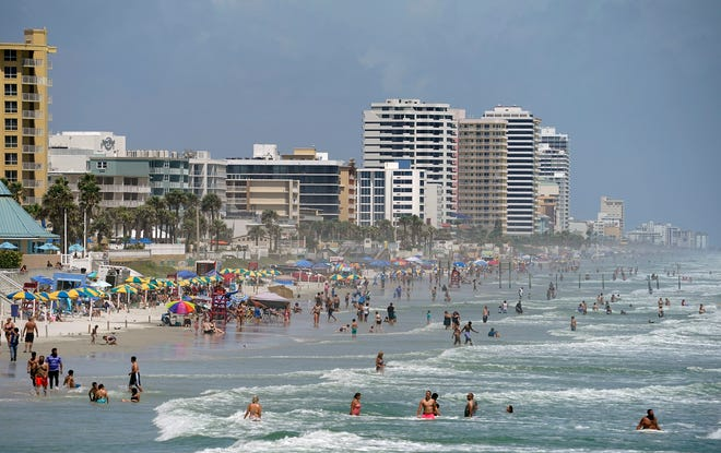Cloudy skies and temperatures in the upper 80s brought out bunches of beachgoers Sunday afternoon, Aug. 23, 2020.