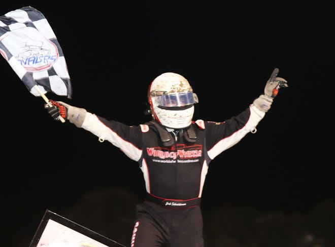 Josh Schneiderman, Danville, celebrates his Sprint Invader feature win at 34 Raceway on Saturday.