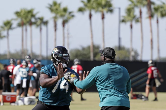 Jacksonville Jaguars offensive tackle Cam Robinson (74) performs a drill during an NFL football workout, Thursday, Aug. 13, 2020, in Jacksonville, Fla. (AP Photo/John Raoux)