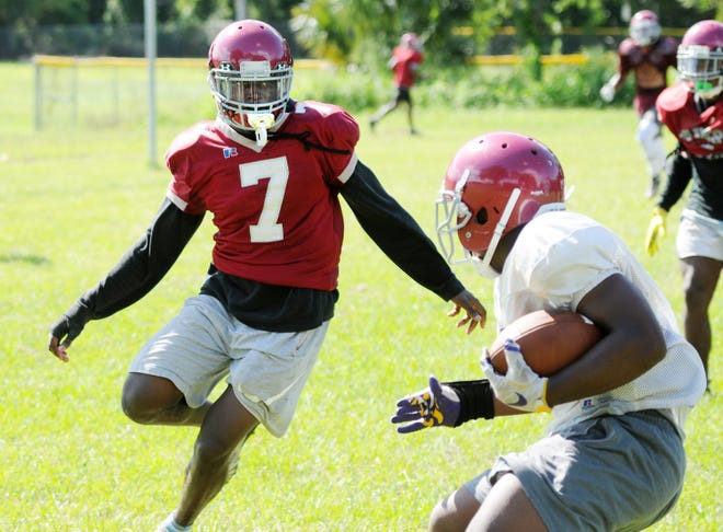 Raines linebacker Derek Nealy (7) approaches a ball carrier during a 2019 football practice. High school teams in Jacksonville can begin full practices Monday for the first time since COVID-19 halted play in March. [Bob Self/Florida Times-Union]