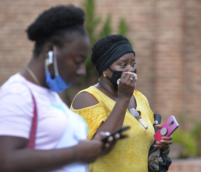 As she finished speaking Sunday, Michelina Smith, the great-granddaughter of Jacksonville lynching victim, Benjamin Hart who was an innocent Black man, wiped tears from her eyes. Her cousin Samelia Adams also a great-grand-daughter comforted her at a commemoration including a soil collection from the site where Hart was lynched Aug. 24, 1923.