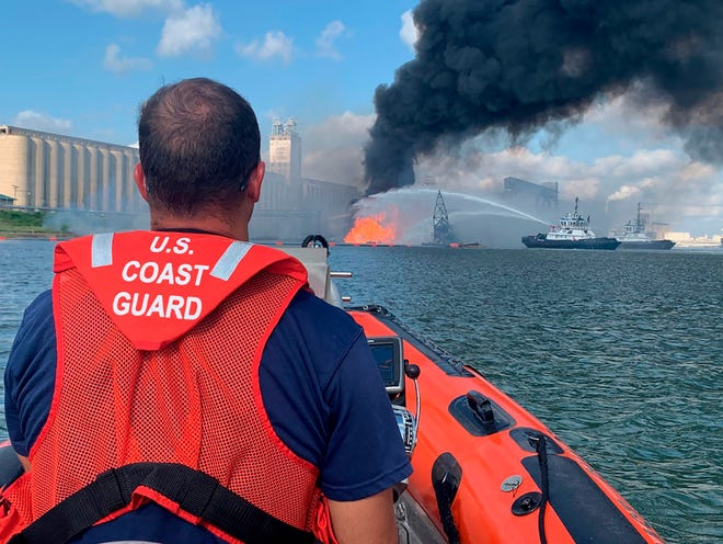 Coast Guard crews respond to a dredge on fire in the Port of Corpus Christi Ship Channel on Friday in Corpus Christi, Texas.