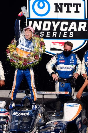 Takuma Sato, of Japan, celebrates winning the Indianapolis 500 IndyCar auto race at the Indianapolis Motor Speedway on Sunday in Indianapolis.