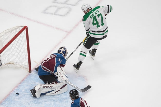 Colorado Avalanche goalie Philipp Grubauer gives up a goal to Dallas' Alexander Radulov (47) during the first period of their second-round playoff series Saturday. [Jason Franson/The Canadian Press via AP]