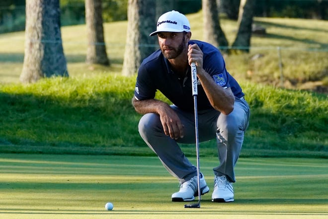 Dustin Johnson lines up his putt on the 17th hole during the third round of The Northern Trust at TPC Boston on Saturday in Norton, Mass. [AP Photo/Charles Krupa]