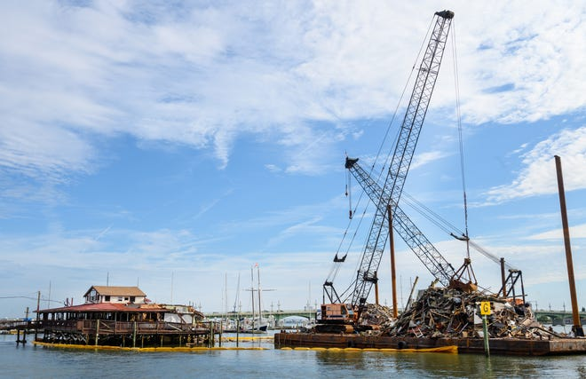 Debris from the demolition of the old Santa Maria restaurant in St. Augustine sits on a barge in the Matanzas River on Friday. [PETER WILLOTT/THE RECORD]