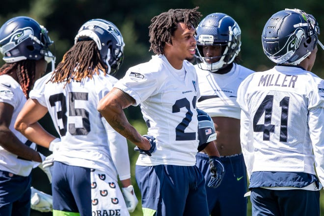 Seahawks cornerback Quinton Dunbar stands with teammates on his first day at training camp in Renton, Wash., on Aug. 16, 2020.