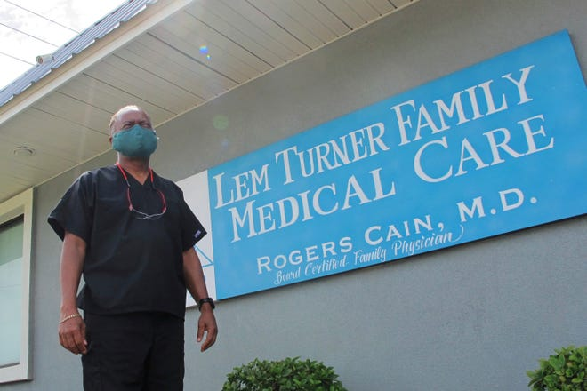 Dr. Rogers Cain stands outside his family medical clinic in north Jacksonville. Over the past two decades, he has seen the county health department gutted of money and people, hampering Duval's ability to respond to outbreaks, including a small cluster of tuberculosis cases in 2012. [Jason Dearen/The Associated Press]