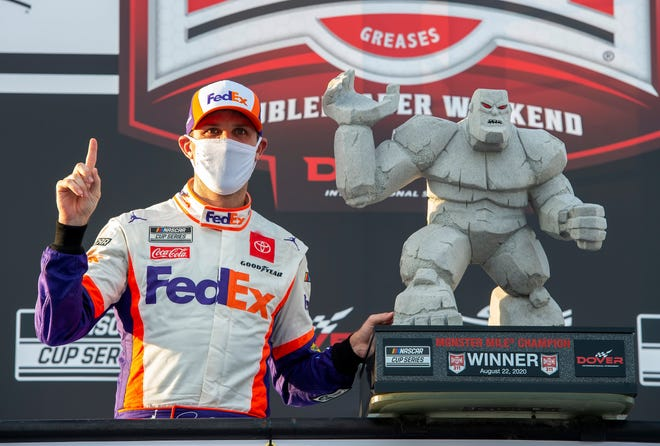 Denny Hamlin celebrates in Victory Lane after winning the NASCAR Cup Series auto race at Dover International Speedway. JASON MINTO/AP
