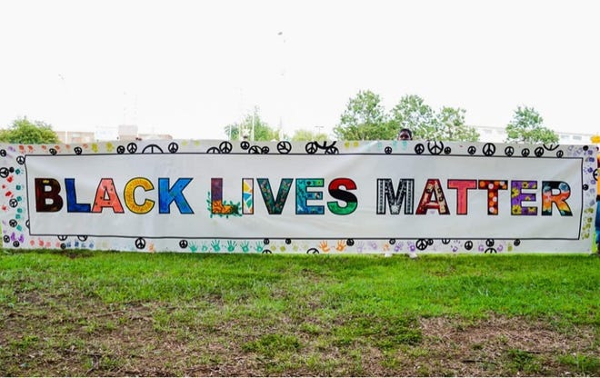 A second Black Lives Matter banner created by local artists was completed Saturday, Aug. 22 in downtown Burlington. [SUBMITTED PHOTO]
