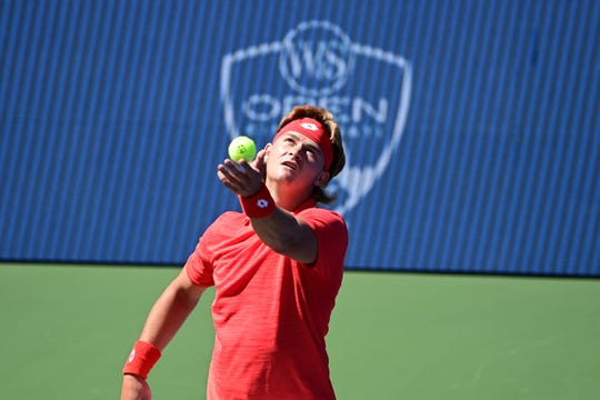 JJ Wolf, of Cincinnati, Ohio, serves in the first round of qualifying at the 2020 Western & Southern Open at the USTA Billie Jean King National Tennis Center in Flushing, New York. Wolf won his first two qualifying matches to earn a spot in the main draw.