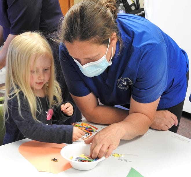 Eva Wise, 3, and her mother Amity Wide work on a Paw Patrol themed craft at Chili Crossroads Bible Church during a recent open house for the new preschool starting Aug. 31. The church is also providing after-school care for older kids and a no-school camp for elementary students not returning to in-person instruction.