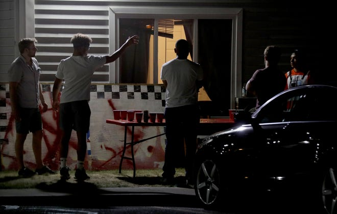 College aged men play beer pong at the Deerfield Village Apartments on Aug. 23. The apartment complex had several police officers show up on Aug. 20th to break up large parties.