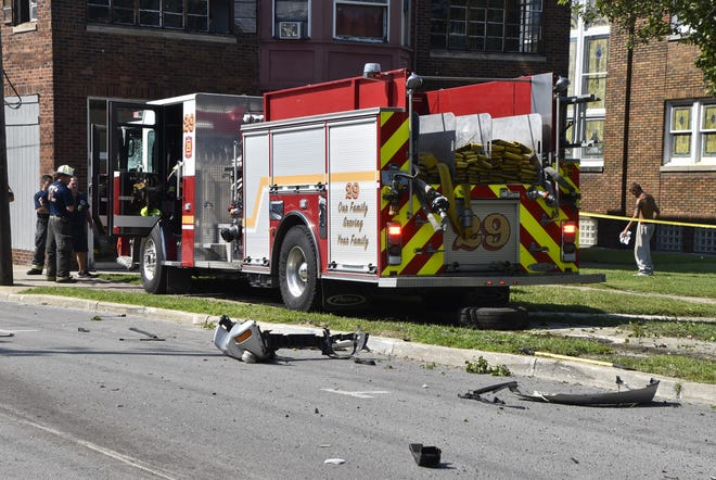 An Indianapolis Fire Department fire engine is damaged after a crash that resulted in the death of a 71-year-old woman.
