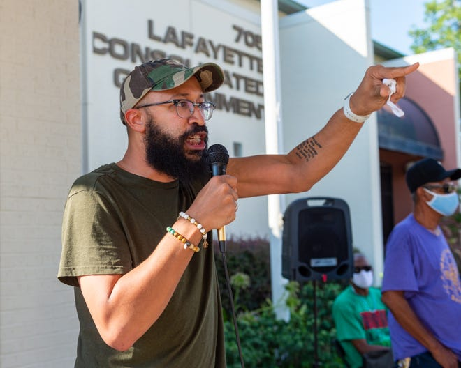 Jamal Taylor speaking at rally where community activist express their frustrations and demand racial justice from the leaders of Lafayette on Sunday.