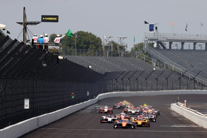 Scott Dixon leads the field down the front straight Sunday in the 104th Indianapolis 500, run without fans in the Indianapolis Motor Speedway stands.