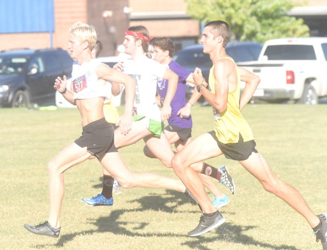 The group of Whit Lawrence, Ky Bickford, Tyler Firment, Andrew Westphal and first-year head coach Wil Norris take off at the start of the 1.5-mile Blue-Gold meet held Friday evening at Mountain Home High School.